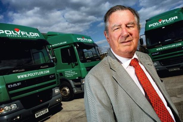 James Halstead standing in front of the company's lorries