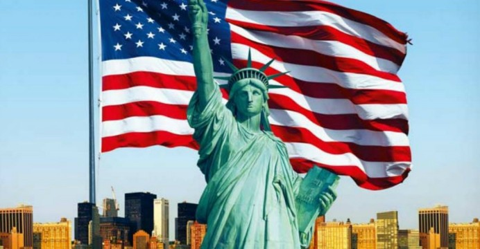 Statue of Liberty in-front of US flag